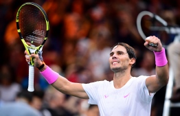 Spain's Rafael Nadal celebrates after winning against France's Jo-Wilfried Tsonga during their men's singles quarter-final tennis match at the ATP World Tour Masters 1000 - Rolex Paris Masters - indoor tennis tournament at The AccorHotels Arena in Paris on November 1, 2019. (Photo by MARTIN BUREAU / AFP)