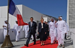 Sheikh Khaled bin Mohammed bin Zayed al-Nahyan (2nd R) welcomes Claude Chirac, the daughter of late French president Jacques Chirac, during a ceremony in Abu Dhabi marking the second anniversary of the Emirati capital's Louvre Museum on November 11, 2019. - The Louvre Abu Dhabi celebrated two years since it opened its doors, as the fate of the world's most expensive painting remains unknown. Leonardo da Vinci's Salvator Mundi was supposed to go on display at the museum in September 2018, but, to everyone's surprise, the United Arab Emirates said the same month it was postponing the hanging. (Photo by KARIM SAHIB / AFP)