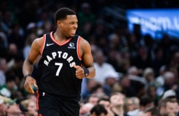 (FILES) In this file photo taken on October 24, 2019 Kyle Lowry #7 of the Toronto Raptors reacts in the second half against the Boston Celtics at TD Garden in Boston, Massachusetts. - Toronto Raptors point guard Kyle Lowry will miss at least the next two weeks of the NBA season while Spanish forward Serge Ibaka is sidelined indefinitely, the club announced Saturday. (Photo by Kathryn Riley / GETTY IMAGES NORTH AMERICA / AFP)