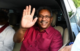 Sri Lanka's President-elect Gotabaya Rajapaksa waves at supporters as he leaves the election commission office in Colombo on November 17, 2019. - Gotabaya Rajapaksa, who spearheaded the brutal crushing of the Tamil Tigers 10 years ago, stormed to victory on November 17 in Sri Lanka's presidential elections, seven months after Islamist extremist attacks killed 269 people. (Photo by Ishara S. KODIKARA / AFP)