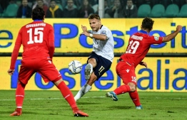 Italy's forward Ciro Immobile (C) shoots on goal during the Euro 2020 1st round Group J qualifying football match Italy v Armenia on November 18, 2019 at the Renzo-Barbera stadium in Palermo. (Photo by Andreas SOLARO / AFP)