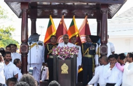 Sri Lanka's new president Gotabaya Rajapaksa (C) speaks after taking the oath of office during his swearing-in ceremony at the Ruwanwelisaya temple in Anuradhapura on November 18, 2019. - Sri Lanka's new president Gotabaya Rajapaksa was sworn in November 18 at a Buddhist temple revered by his core Sinhalese nationalist supporters, following an election victory that triggered fear and concern among the island's Tamil and Muslim minority communities. (Photo by Lakruwan WANNIARACHCHI / AFP)