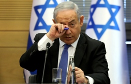 Israeli Prime Minister Benjamin Netanyahu gestures during a meeting of the right-wing bloc at the Knesset (Israeli parliament) in Jerusalem on November 20, 2019. (Photo by GALI TIBBON / AFP)