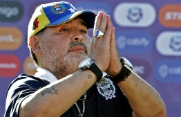 (FILES) In this file photo taken on November 02, 2019, Gimnasia y Esgrima team coach Diego Armando Maradona gestures to supporters as he leaves the field after an Argentina First Division Superliga football match against Estudiantes, at El Bosque stadium, in La Plata, Buenos Aires province, Argentina. - Argentine legend Diego Maradona quit as coach of Superliga side Gimnasia, less than three months after taking over, a club source told AFP on November 19, 2019. (Photo by ALEJANDRO PAGNI / AFP)