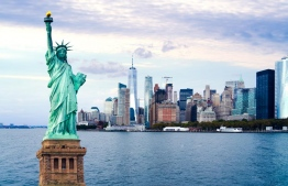 A photograph of New York City seen behind the Statue of Liberty in the United States. PHOTO: AFP