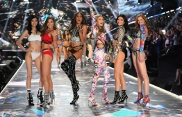 (FILES) In this file photo taken on November 09, 2018 (FromL) Chinese model Ming Xi, US model Grace Elizabeth, French model Cindy Bruna, US model Gigi Hadid, US model Kendall Jenner and British model Alexina Graham walk the runway at the 2018 Victoria's Secret Fashion Show at Pier 94 in New York City. - US lingerie brand Victoria's Secret has announced that its iconic fashion show that brings together millions of viewers would not take place this year, the brand wanting to evolve its marketing strategy, after polemics and poor results. (Photo by TIMOTHY A. CLARY / AFP)