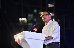 Adam Shareef speaking at a PPM?PNC rally in 2019. PHOTO: HUSSAIN WAHEED/ MIHAARU