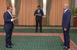 Fuwad Thowfeek being appointed to Elections Commission. PHOTO: PRESIDENTS OFFICE