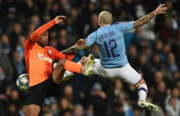 Shakhtar Donetsk's Brazilian forward Tete (L) challenges Manchester City's Spanish defender Angelino (R) during the UEFA Champions League football Group C match between Manchester City and Shakhtar Donetsk at the Etihad Stadium in Manchester, north west England on November 26, 2019. (Photo by Oli SCARFF / AFP)