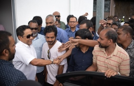 Former President Abdulla Yameen greets his supporters as he arrives at the Criminal Court for the verdict hearing of his money laundering trial. PHOTO: NISHAN ALI / MIHAARU