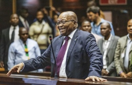 (FILES) In this file photo taken on October 15, 2019 South Africa's embattled former president Jacob Zuma (C) appears in the Pietermaritzburg High Court where he is appearing on corruption charges, in what would be the first time he faces trial for graft despite multiple accusations, in Pietermaritzburg. - A South African court on November 29, 2019, dismissed former president Jacob Zuma's attempts to appeal against his corruption trial related to a 1990s arms deal. (Photo by Michele Spatari / POOL / AFP)