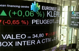 The stock tickers and financial display are pictured at the headquarters of the Pan-European stock exchange Euronext in La Defense district, near Paris on November 21,2019 (Photo by ERIC PIERMONT / AFP)