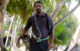 CK Kannan poses in front coconut palms. PHOTO: ABDULLA AURAF/ THE EDITION