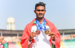 Triumphant Maldivian Athlete Hassan Saaid shows off the gold and bronze he bagged at the South Asian Games (SAG) 2019, in the 100-meter and 200-meter dash, respectively. PHOTO: MALDIVES OLYMPIC COMMITTEE/ ABDULLA ABEED