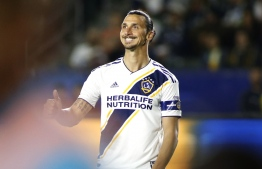 (FILES) In this file photo taken on June 02, 2019 Zlatan Ibrahimovic of Los Angeles Galaxy reacts during a football match game against the New England Revolution at Dignity Health Sports Park in Carson, California. - Ibrahimovic has acquired roughly a quarter of the shares in Stockholm-based football team Hammarby, the club said on November 27, 2019. The 38-year-old former Juventus, Barcelona, Paris Saint-Germain and Manchester United forward has bought 50 percent of American sporting and entertainment company Anschutz Entertainment Group's (AEG) stake in the Swedish team, according to a separate statement by AEG. (Photo by Katharine Lotze / GETTY IMAGES NORTH AMERICA / AFP)