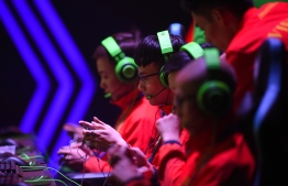 Gamers from the Vietnam team compete in the qualifying rounds of the eSports event between Malaysia and Vietnam at the SEA Games (Southeast Asian Games) in Manila on December 5, 2019. (Photo by TED ALJIBE / AFP)