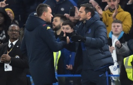 Aston Villa's English assistant manager John Terry (L) shakes hands with Chelsea's English head coach Frank Lampard after the English Premier League football match between Chelsea and Aston Villa at Stamford Bridge in London on December 4, 2019. (Photo by Glyn KIRK / AFP) / RESTRICTED TO EDITORIAL USE. No use with unauthorized audio, video, data, fixture lists, club/league logos or 'live' services. Online in-match use limited to 120 images. An additional 40 images may be used in extra time. No video emulation. Social media in-match use limited to 120 images. An additional 40 images may be used in extra time. No use in betting publications, games or single club/league/player publications. /