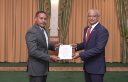 President Ibrahim Mohamed Solih presenting the Letter of Appointment to the new Prosecutor General (PG) Hussain Shameem. PHOTO: PRESIDENT'S OFFICE