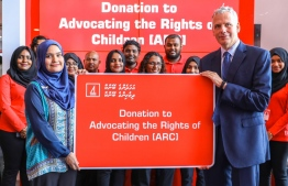 Bank of Maldives CEO and Managing Director Tim Sawyer hands over donation to Advocating for the Rights of Children (ARC). PHOTO: BML
