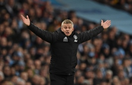 Manchester United's Norwegian manager Ole Gunnar Solskjaer reacts on the touchline during the English Premier League football match between Manchester City and Manchester United at the Etihad Stadium in Manchester, north west England, on December 7, 2019. PHOTO: OLI SCARFF / AFP