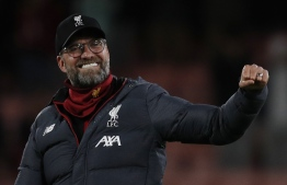 Liverpool's German manager Jurgen Klopp celebrates their victory during the English Premier League football match between Bournemouth and Liverpool at the Vitality Stadium in Bournemouth, southern England on December 7, 2019. (Photo by Adrian DENNIS / AFP)