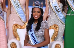 Newly crowned Miss World 2019 Miss Jamaica Toni-Ann Singh smiles as she poses with her crown during the Miss World Final 2019 at the Excel arena in east London on December 14, 2019. (Photo by DANIEL LEAL-OLIVAS / AFP)