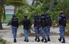 Police taking a suspect under custody during the special joint operation conducted with MNDF in Maduvvari, Raa Atoll. PHOTO: POLICE