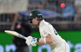 Australia's Steve Smith avoids a bouncer on day three of the first Test cricket match between Australia and New Zealand at the Perth Stadium in Perth on December 14, 2019. (Photo by PETER PARKS / AFP) /