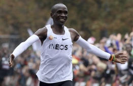 The moment in Vienna when Eliud Kipchoge made sporting history with the first sub-two-hour marathon. Photograph: Ronald Zak/AP