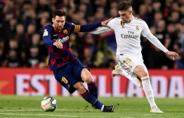 """Barcelona's Argentine forward Lionel Messi (L) during the """"El Clasico"""" Spanish League football match between Barcelona FC and Real Madrid CF at the Camp Nou Stadium in Barcelona on December 18, 2019, PHOTO: JOSEP LAGO / AFP"""