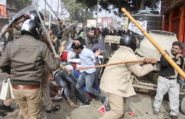 In this photo taken on December 19, 2019 police beat protesters with sticks during a demonstration against India's new citizenship law in Lucknow. - Indians defied bans on assembly on December 19 in cities nationwide as anger swells against a citizenship law seen as discriminatory against Muslims, following days of protests, clashes and riots that have left six dead. (Photo by STR / AFP)