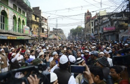 Protesters gather during demonstrations against India's new citizenship law in Allahabad on December 20, 2019. - Fresh clashes between Indian police and demonstrators erupted on December 20 after more than a week of deadly unrest triggered by a citizenship law seen as anti-Muslim. (Photo by SANJAY KANOJIA / AFP)
