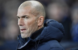 Real Madrid's French coach Zinedine Zidane looks on before the UEFA Champions League Group A football match between Club Brugge and Real Madrid CF at the Jan Breydel Stadium in Bruges on December 11, 2019. (Photo by JOHN THYS / AFP)