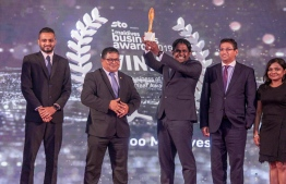 Ooredoo Maldives collecting the prestigious Business of the Year in the Elite Awards category at Maldives Business Awards 2019. PHOTO: OOREDOO MALDIVES