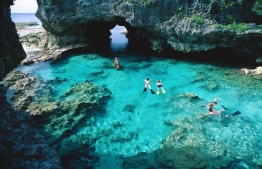 Swimmers snorkeling in the cerulean waters of Niue's rock pools. PHOTO: Casey Mahaney/Lonely Planet Images/Getty Images.