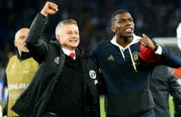 Manchester United's midfielder Paul Pogba (R) and Manager Ole Gunnar Soskjaer. PHOTO: AFP