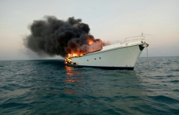 The yacht in Kudavilingili that caught fire. PHOTO: MALDIVES NATIONAL DEFENCE FORCE