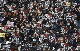 People march through the Causeway Bay district during a pro-democracy rally in Hong Kong on January 1, 2020. - Tens of thousands of protesters marched in Hong Kong during a massive pro-democracy rally on New Year's Day, looking to carry the momentum of their movement into 2020. (Photo by Philip FONG / AFP)