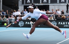 Serena Williams of the US hits a return against Camila Giorgi of Italy during their women's singles first round match during the Auckland Classic tennis tournament in Auckland on January 7, 2020. (Photo by MICHAEL BRADLEY / AFP)
