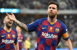 Barcelona's Argentine forward Lionel Messi (R) celebrates his goal during the Spanish Super Cup semi final between Barcelona and Atletico Madrid on January 9, 2020, at the King Abdullah Sport City in the Saudi Arabian port city of Jeddah (Photo by FAYEZ NURELDINE / AFP)