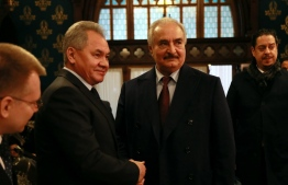 This handout picture released by the Russian Foreign Ministry on January 13, 2020 shows Russian Defence Minister Sergei Shoigu shaking hands with Libya's military strongman Khalifa Haftar in Moscow. (Photo by HO / RUSSIAN FOREIGN MINISTRY / AFP) /