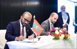 Minister of Finance Ibrahim Ameer signing the agreement for a loan granted by the OPEC Fund For International Development (OFID). PHOTO: HUSSAIN WAHEED/ MIHAARU