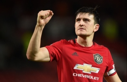 Manchester United's English defender Harry Maguire gestures at the end of the English Premier League football match between Manchester United and Norwich City at Old Trafford in Manchester, north west England, on January 11, 2020. (Photo by Oli SCARFF / AFP) / RESTRICTED TO EDITORIAL USE. No use with unauthorized audio, video, data, fixture lists, club/league logos or 'live' services. Online in-match use limited to 120 images. An additional 40 images may be used in extra time. No video emulation. Social media in-match use limited to 120 images. An additional 40 images may be used in extra time. No use in betting publications, games or single club/league/player publications. /