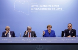 (LtoR) Special Representative and Head of the United Nations Support Mission in Libya (UNSMIL) Ghassan Salame; Secretary-General of the United Nations (UN) Antonio Guterres; German Chancellor Angela Merkel and German Foreign Minister Heiko Maas give a press conference at the end of a Peace summit on Libya at the Chancellery in Berlin on January 19, 2020. - Held under the auspices of the UN, the summit's main goal was to get foreign powers wielding influence in the region to stop interfering in the war -- be it through the supply of weapons, troops or financing. (Photo by AXEL SCHMIDT / POOL / AFP)