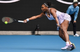 Serena Williams of the US hits a return against Russia's Anastasia Potapova during their women's singles match on day one of the Australian Open tennis tournament in Melbourne on January 20, 2020. (Photo by William WEST / AFP) /