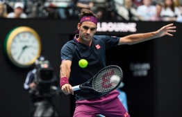 Switzerland's Roger Federer hits a return against Steve Johnson of the US during their men's singles match on day one of the Australian Open tennis tournament in Melbourne on January 20, 2020. (Photo by William WEST / AFP) /