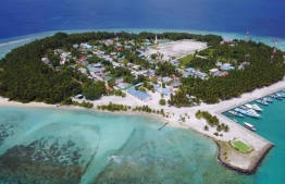 The Island of Bandhidhoo, Dhaalu Atoll, as seen from an aerial photograph. The 22-hectare island remains largely barren with coconut groves on the frindes of its eastern coastline. PHOTO: BANDIDHOO / FACEBOOK