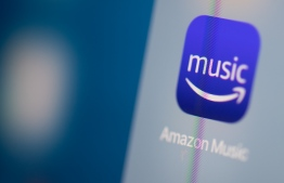 (FILES) This file illustration picture taken on July 24, 2019 in Paris shows the logo of the US music streaming application Amazon Music on the screen of a tablet. - Amazon on January 22, 2020 said that its streaming music service has won more than 55 million subscribers, closing in on Apple Music.Amazon Music, however, still has a long way to go to catch up to Spotify, which boasts 248 million users, including 113 million paid subscribers. (Photo by Martin BUREAU / AFP)