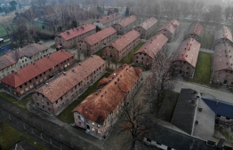 (FILES) An aerial picture taken on December 15, 2019 in Oswiecim, Poland, shows a view of the blocks of Auschwitz I, which was part of former German Nazi death camp Auschwitz-Birkenau. The site has been turned into a museum and memorial site. - Some two hundred former prisoners of the Nazi-run Auschwitz-Birkenau extermination camp, a symbol of the Holocaust of the Jews, will visit the site on January 27, 2020 to commemorate the 75th anniversary of its liberation. (Photo by Pablo GONZALEZ / AFP)