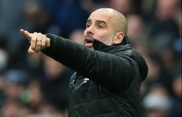 Manchester City's Spanish manager Pep Guardiola gestures on the touchline during the English FA Cup fourth round football match between Manchester City and Fulham at the Etihad Stadium in Manchester, north west England, on January 26, 2020. (Photo by Lindsey Parnaby / AFP) / RESTRICTED TO EDITORIAL USE. No use with unauthorized audio, video, data, fixture lists, club/league logos or 'live' services. Online in-match use limited to 120 images. An additional 40 images may be used in extra time. No video emulation. Social media in-match use limited to 120 images. An additional 40 images may be used in extra time. No use in betting publications, games or single club/league/player publications. /